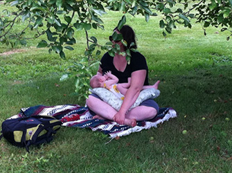 Nursing on the road, under an apple tree. Photo credit: Sean Smith